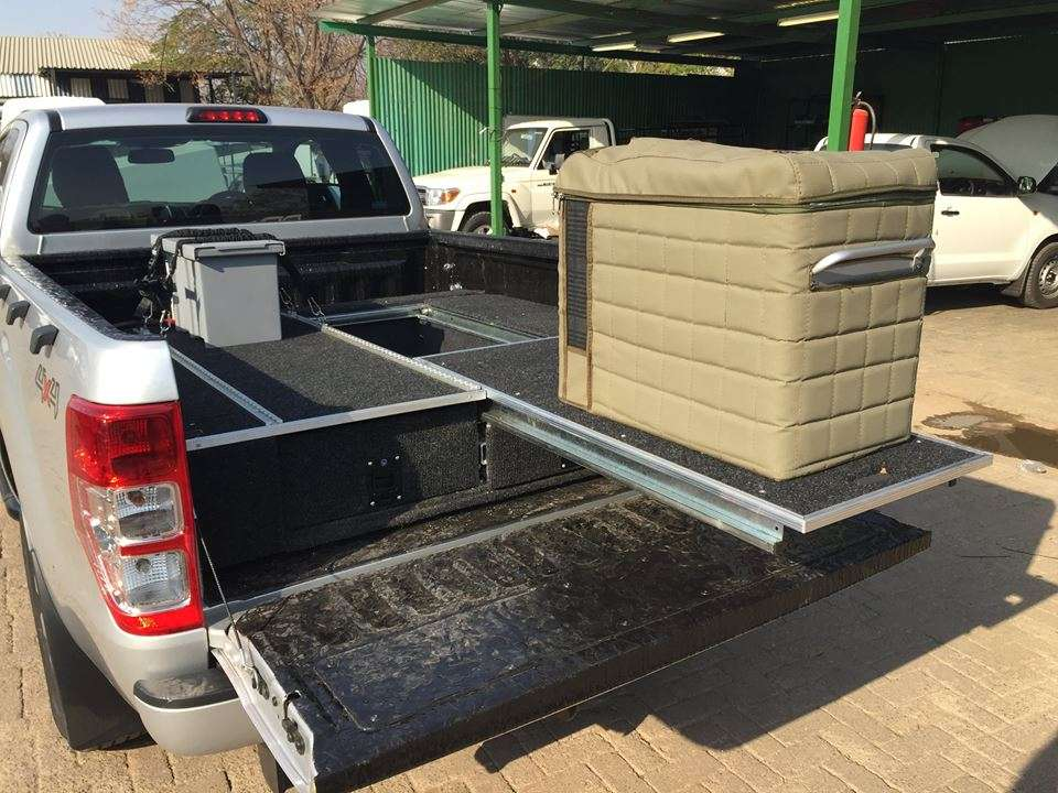 Vehicle Specific Drawer System with Portable Power Pack and Fridge